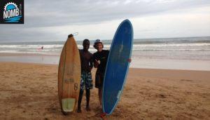 NOMB Surfer Annette enjoying a surflesson in Ghana