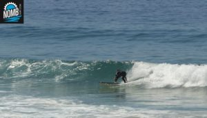 NOMB Surfer Reto working on his bottom turns